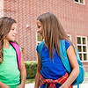 un15.09 / New photo requested of girls talking privately together / what characterizes children's friendships.  Choice  14 of 17
