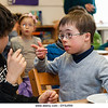 Un16.16 / New photo requested of child with down syndrome in classroom setting, choice 8 of 13