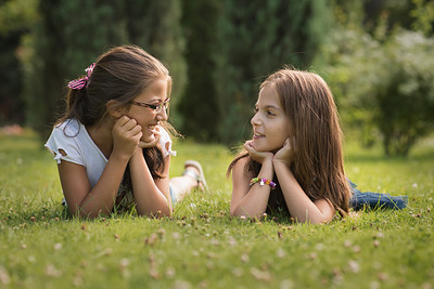 un15.09 / New photo requested of girls talking privately together / what characterizes children's friendships.  Choice  13 of 17
