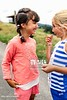 un15.09 / New photo requested of girls talking privately together / what characterizes children's friendships.  Choice  11 of 17