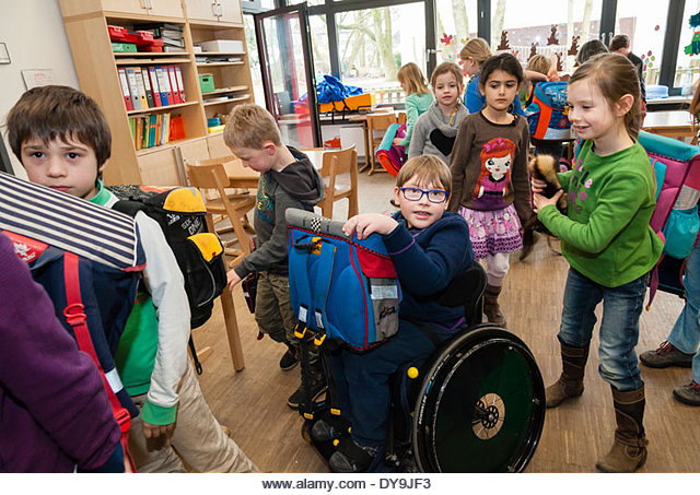 Un16.16 / New photo requested of child with down syndrome in classroom setting, choice 6 of 13