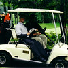 2000tpc_011_york_and_goetzke_in_cart_near_hole8_tee_signature_092300