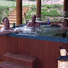 03tpc002_clifton_fournier_and_song_in_hot_tub_091303
