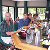 04tpc_015_boys_enjoying_clubhouse_food_between_rounds_092404