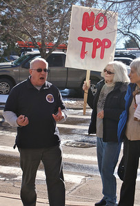 Union member speaks out against Trans Pacific Partnership (TPP) out side of Rep. Jared Polis'  office in Boulder, Colorado.