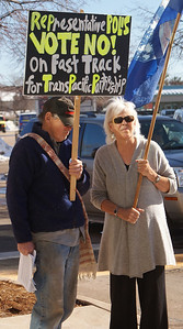 Opponents of a fast track on the Trans Pacific Partnership (TPP), demonstrate outside the district office of Rep Jared Polis, in Boulder, Co.
