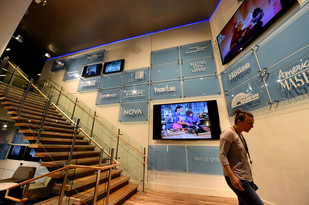 . The four floors at Twin Cities Public Television are tied together by grand stairways, and the second-floor landing is lined with six oversized screens, each featuring different TPT programming.  (Pioneer Press: Jean Pieri)