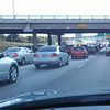 "LETMEIN - ""me first"" driver.<br /> I35 TRAFFIC ON SATURDAY..Note the wide gap in front of us?  Notice that we are in right hand turn lane about to exit soon.  What would you bet that the drivers in that lane will squeeze in the trough traffic lane before the driver has to exit?  What is the problem with drivers who cannot stay tn the through traffic lane like eveyrone else?"
