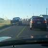 <h1>Driving on Shoulder:</h1> <em>WhatShoulder?</em> 10/29/12 @7:02 PM. --<b>This image was taken with a cell phone -- Do you see what that pickup driver is doing? Recently police ticked drivers on 2222/620 for doing just that.  So is driving on the shoulder illegal?  <em>Yup!</em>  (FYI: This line of cars is backed up on E. Parmer Ln & Daussau Road as we were heading back home after a round of golf at ShadowGlen.)<br>  Question that pops into our head is, <br />Why is this driver in such a hurry that he cannot wait to take the proper lane?  <br />Does he actually realize that he is not in the left turn lane?<br />  These questions pop into your head when you see this happen.</b>
