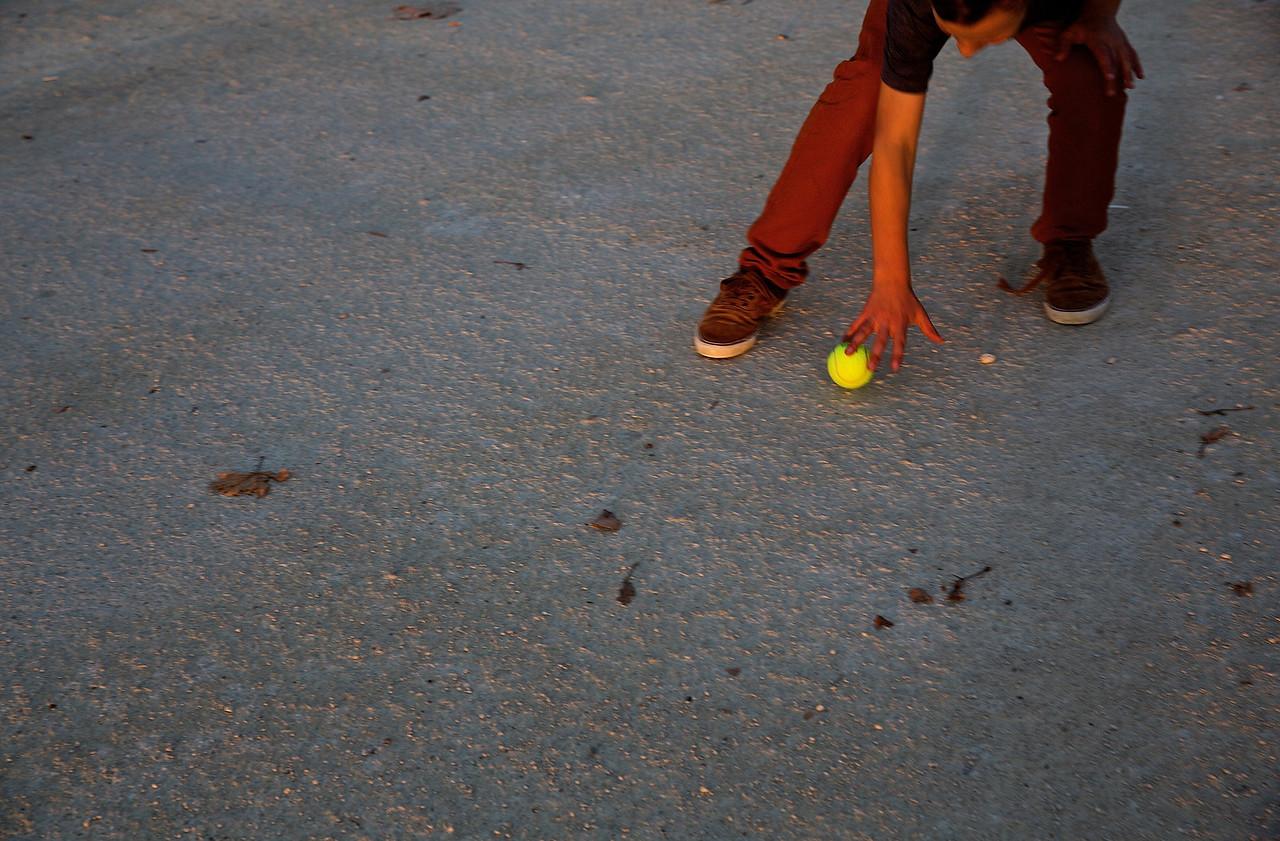 Child Chasing A Ball.