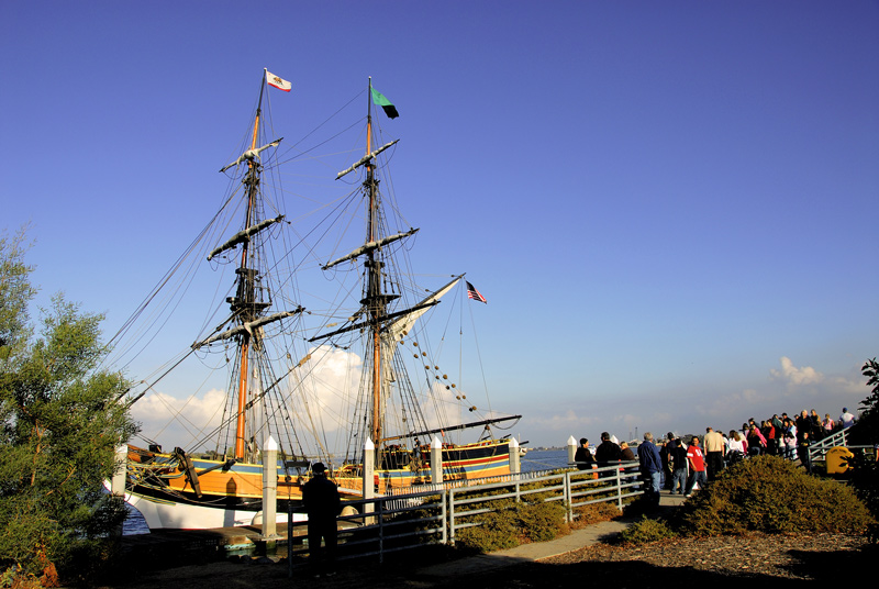 The Lady Washington docked at the pier of Humphrey's Restaurant in Antioch. The people are all lined up to board and sail the ship. It is free to board and observe but to go on a cruise n the delta you have to pay $45.00 per her person.
