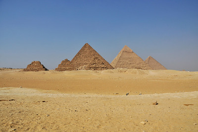 The three Pharaoh's pyramids in the distance with the three smaller queen's pyramids in the foreground.