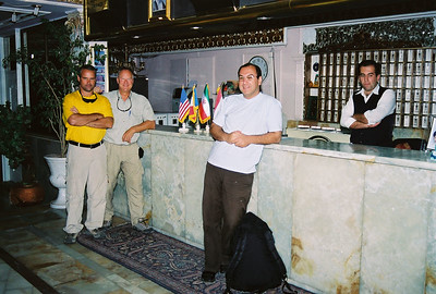 "Hamadan Hotel with Travel Companions and Guide Note the American Flag from Our Gracious Hosts in Hamadan, Iran Our ""city"" guide in front of Don and Dan.  He would travel with us to hand us off to our mountain guide."