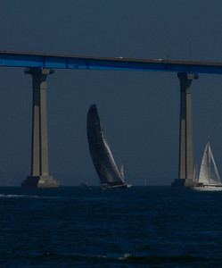 Catching the Light-The United States' entry to the America's Cup Race, The Stars and Stripes is framed by the Coronado Bay Bridge