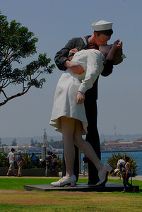 "Set against the North Island Naval Air Station background, the ""Unconditional Surrender"" sculpture,  shows it's enormous size."