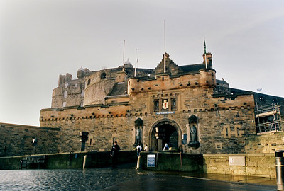 Edinburgh Castle Main Entrance viewed from the Esplanade.  Flanking the entrance are the statues, on the left, Robert the Bruce and on the right William Wallace, known today as Braveheart.