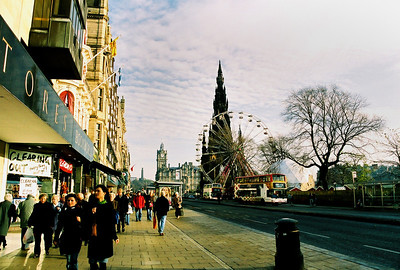 A view east along Princes Street showing the Sir Walter Scott Memorial Tower, the Balmoral Hotel Clock tower, and in the distance, the Time tower on Calton Hill.