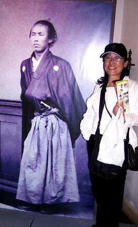 OK.  Now she'll smile. Her hero, Sakamoto Ryoma a self made leader during the Meiji Restoration and founding father of the Japanese navy.