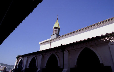 The roof eave of the traditional building on the left shows how well the church blends with its environment.