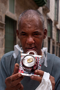 "This man wanted to ""take our picture"" with his beer-can camera.  We took his and bought the ""camera""."