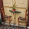 095 - Table and chairs against door - Syros
