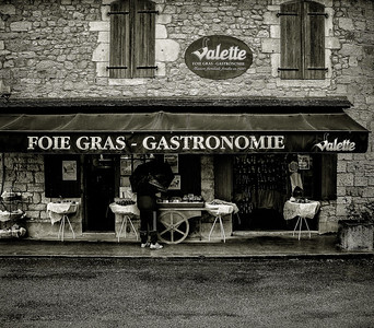 Pictured here is a specialty shop selling the French delicacy Foie Gras.  This photo was taken in May 2013 in the village of Domme, France.  Monochrome conversion was done using Nik Silver Efex Pro 2.