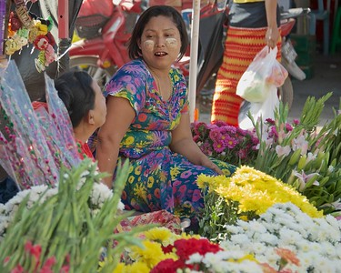 Flower vendor with the ever present betel nut