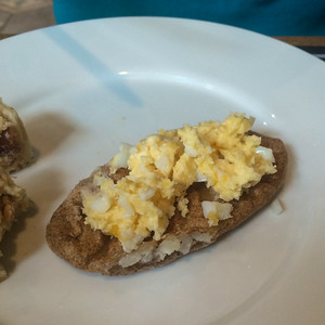 Karelian pie (Karjalanpiiraka) served with hard boiled egg mashed with butter (munavoi), is a traditional breakfast item.