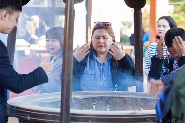 Bathing in incense smoke at Asakusa Sensoji Temple.