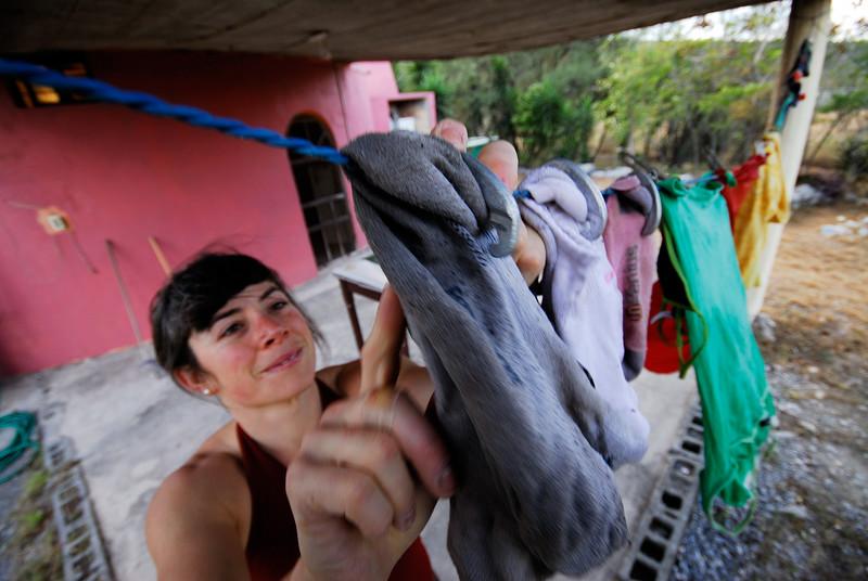 Mandoline Masse-Clark does her laundry at the Casita. Rancho Cerro Gordo. El Potrero Chico. Hidalgo, Nuevo Leon, Mexico.
