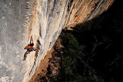 Wolfang Parada climbing Dynasaures, 5.12c, Las Animas Wall. El Salto. Nuevo Leon, Mexico.