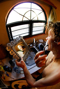Jeremy Blumel shaves in the kitchen sink during a rest day at the Casita. El Potrero Chico, Mexico.