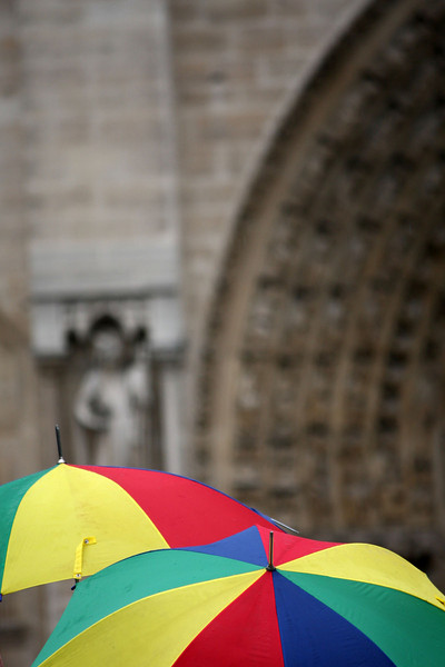 Queuing in front of Notre Dame under the rain.