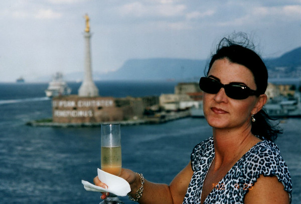 PASSING BETWEEN THE BOOT OF ITALY AND SICILY WITH PROSECO IN HAND