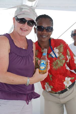 ENJOYING A PITON BEER WITH A LOCAL ON A BOAT IN ST. LUCIA