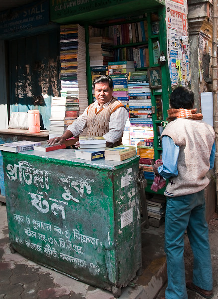 "This is the 2nd hand bookshop area in front of the famous Presidency college of Kolkata. This street is called College Street as there are more than five colleges and two schools just within 100 m on this street. Of these 4 colleges are among the most well known in India -Presidency college (previuosly known as Hindu College), Goenka College of Commerce, Calcutta Medical College, Sanskrit College. This street is also the hub of publishing business of Kolkata (nee Calcutta). There are over 1000 book shops right on this street. A new multistoried book market named - ""Barnoporichoy"" (meaning Learning alphabets in Bangla) is under construction, just within 50m of the place of the photograph. It is also one of the biggest book trade area of Asia and is there for nearly a hundred years."