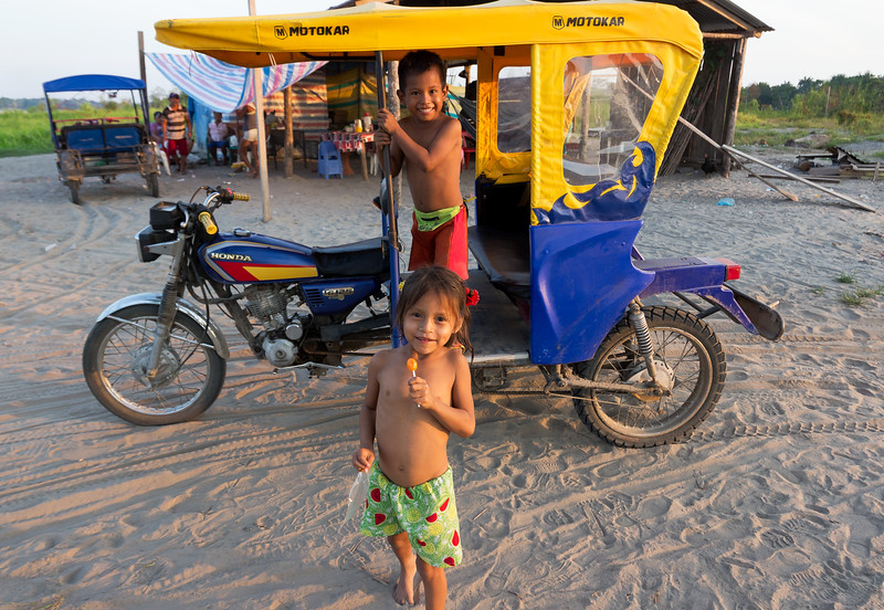 Kids and a mototaxi.