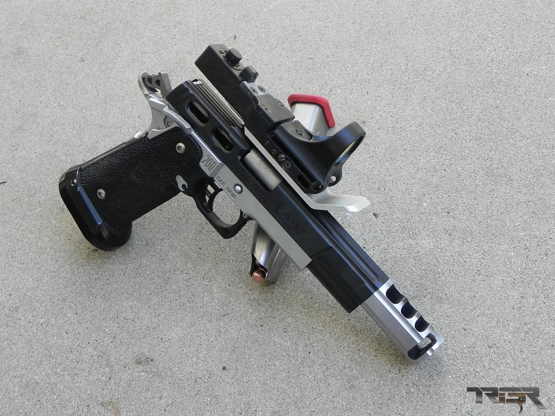 Purpose built STI Open gun. Based off the 1911 platform this wide body pistol is ready to race.