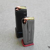 """STI vs Glock Magazines. With a cartridge maxed out to 1.150"""" Factory OAL the STI still has space to go longer. This means more options for powder and bullets."""