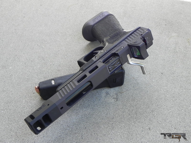 Open Class Glock 34. A compensator is attached to the end of the barrel to channel the gasses from the fired round to counter recoil.