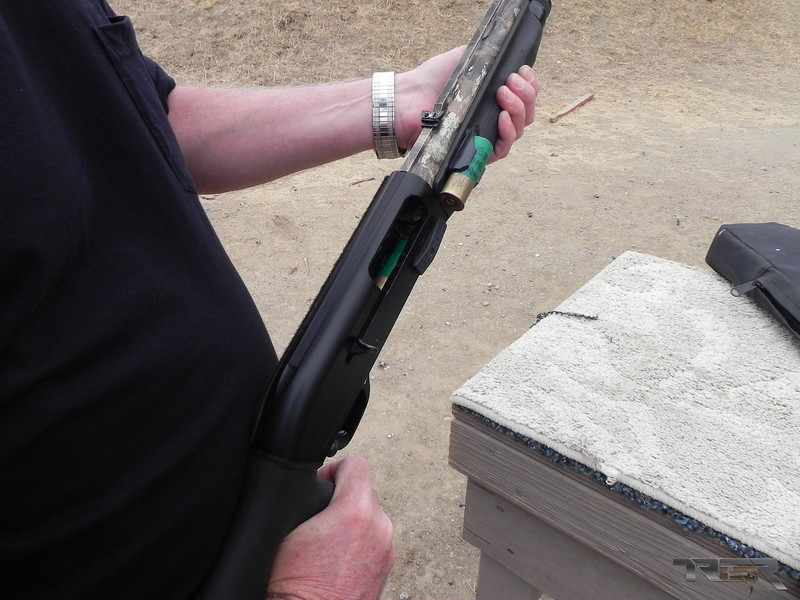Upon further inspection there is a shell jammed on the lifter. This very common jam has caused a number of negligent discharges some point after the unseen round loads itself. This can happen when the gun is bagged or when the shotgun is placed in a rack. At shotgun events this is something that is commonly looked for or should be.