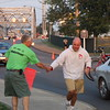 Two great Vermilionites here:  Cliff German, a well known business person, takes time while directing Parking Traffice in to Romp's, to shake Varsity Baseball coach's hand as Jeff Keck is on his daily Run !