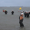 Many wade in the water before their race.