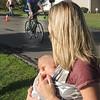 Ashley and Peyton Rawlings watching her husband Scott finishing the Bike race.