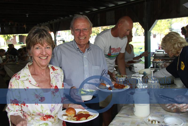Debbie and Dick Zanglin, of Vermilion and in background Brad Qua also of Vermilion.