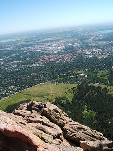 Carl climbing the ridge.  The climbing along the ridge is very easy (just walking at times) but the setting is spectacular.  Boulder is the city you see in the background; the red buildings are the CU campus.