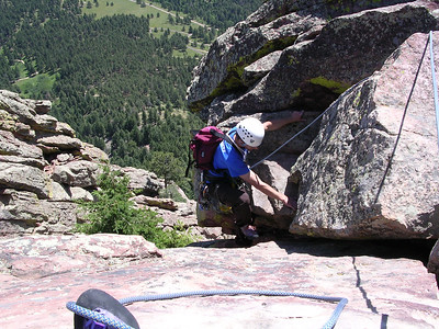 Me pulling the 5.7 roof variation onto the summit.