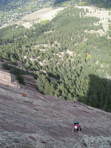 After 3.5 pitches, we caught up with the party in front of us.  They chose to climb the direct finish; we chose to climb the standard finish (which actually share the final pitch, and are only different for 1-2 pitches).  This is Julia on her first ever technical rock climb.