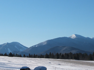 Looking back at the High Peaks region from the junction of Hwy 73 and the road to the ADK Loj.  Algonquin on the right, Wright just below that, and Colden on the left.