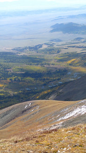 A valley to the east, filled with multicolored aspens and a series of beaver ponds.
